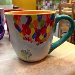 A delightful cape mug decorated with the house from Up #nancyspick