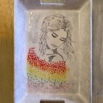A beautiful portrait painted on a medium nesting tray by Kate