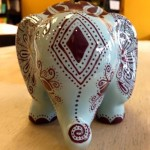 For the elephant lovers who need somewhere to keep their change - an elephant bank painted by Nancy