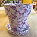 Swirly whirlies on a medium planter painted by Katie